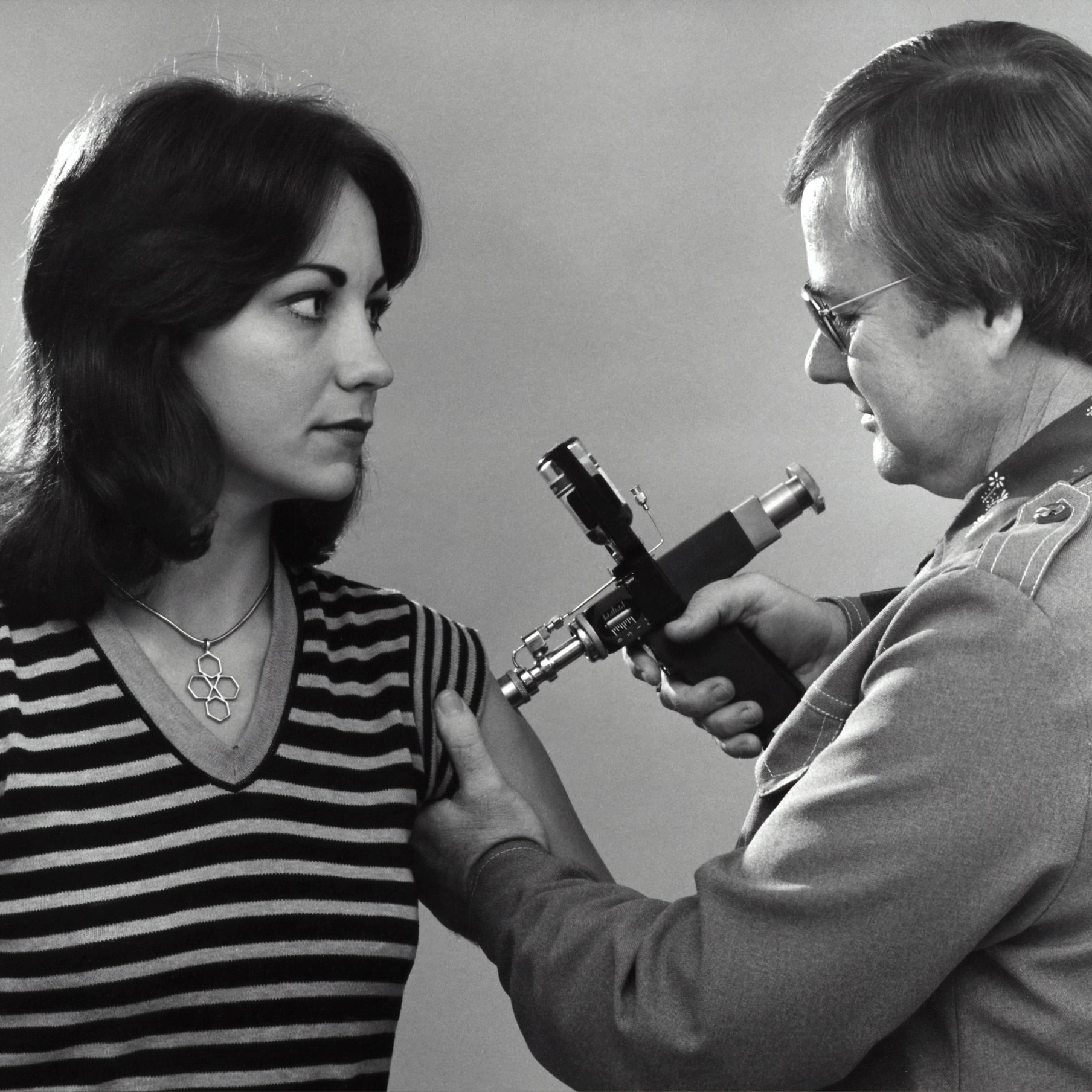 This 1976 photograph shows a woman receiving a vaccination during the nationwide swine flu vaccination campaign. (CDC)